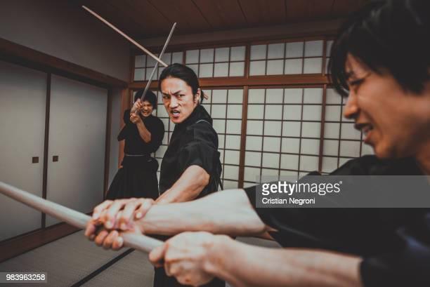 samurai training in a traditional dojo, in tokyo - vangen imagens e fotografias de stock