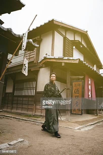 Samurai walking down the village street