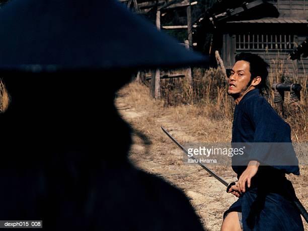 samurai warrior attacks with a sword - 対決 ストックフォトと画像