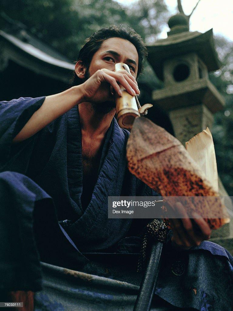 Samurai warrior drinking water : Stock Photo