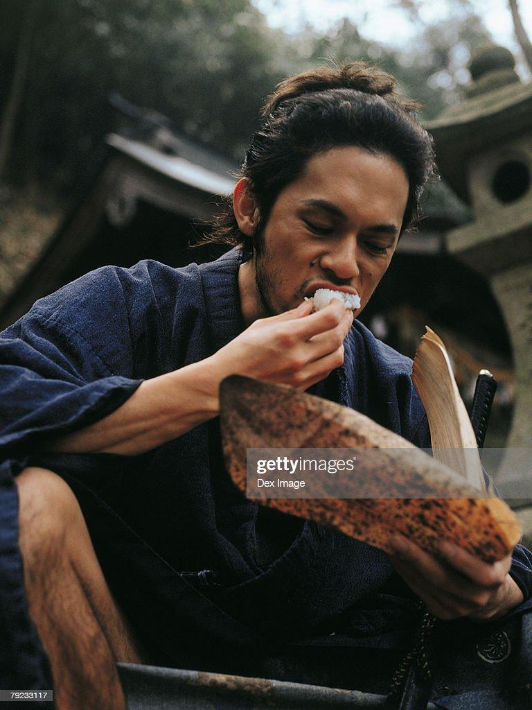 Samurai warrior eating food : Stock Photo