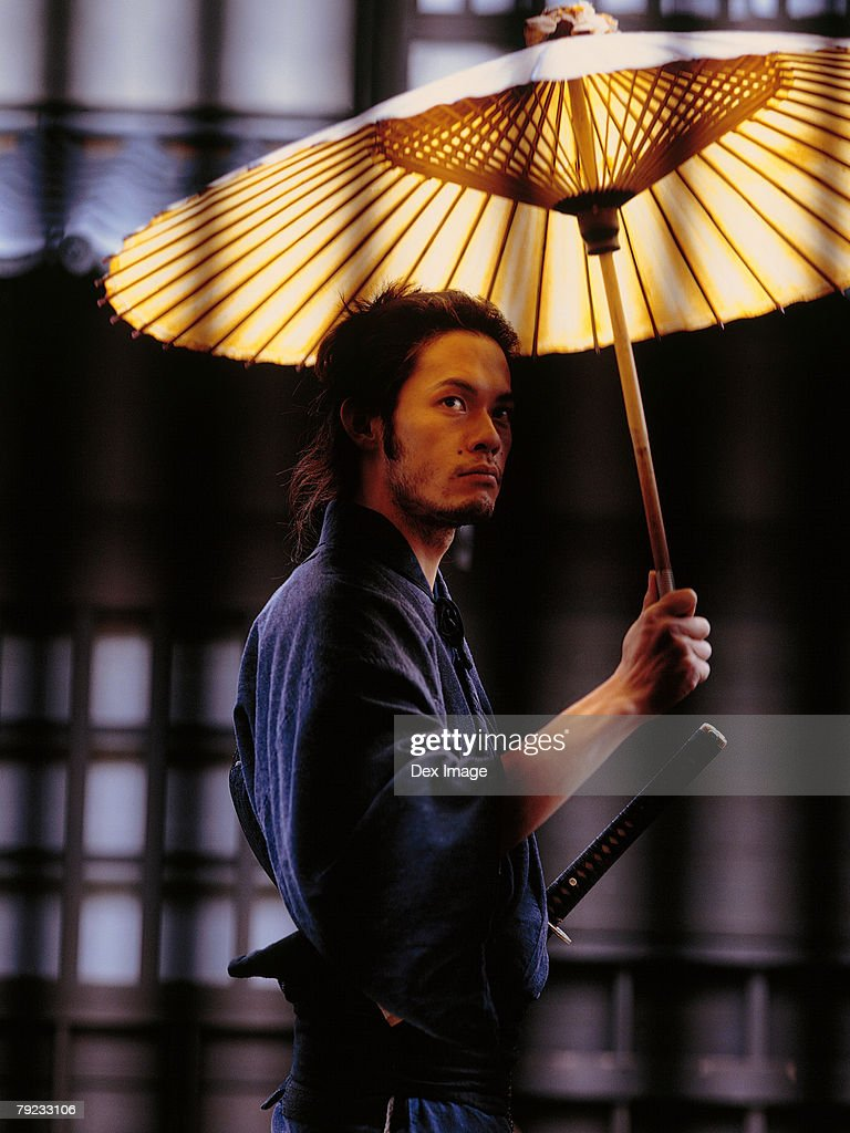 Samurai warrior holding an umbrella : Stock Photo
