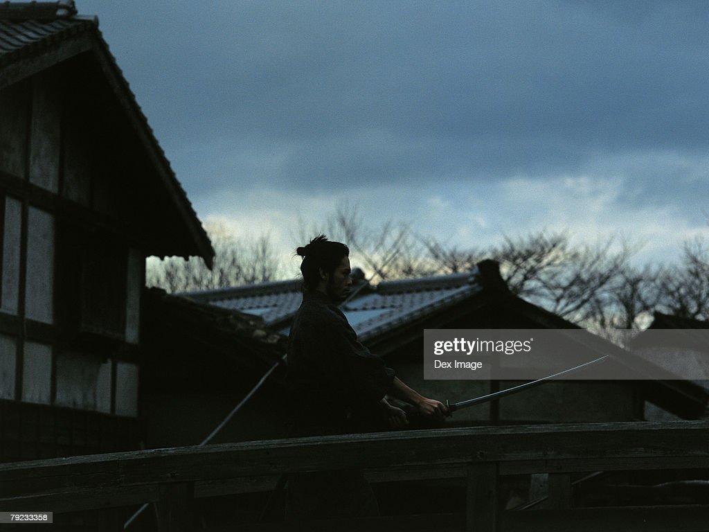 Samurai warrior practicing sword play : Stock Photo