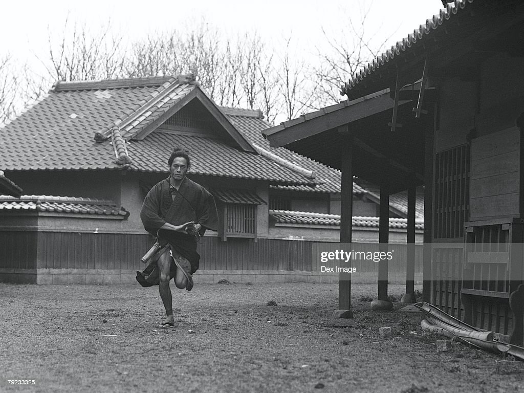 Samurai warrior running with a sword in his hand : Stock Photo