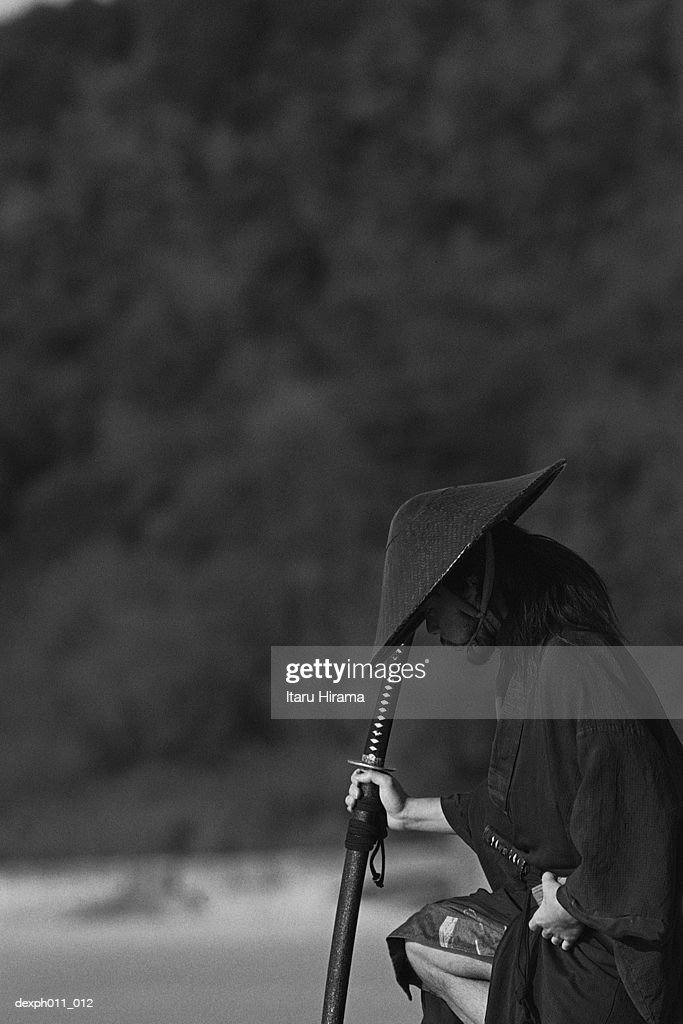 Samurai Warrior Standing On The Seaside Holding A Sword High Res Stock Photo Getty Images