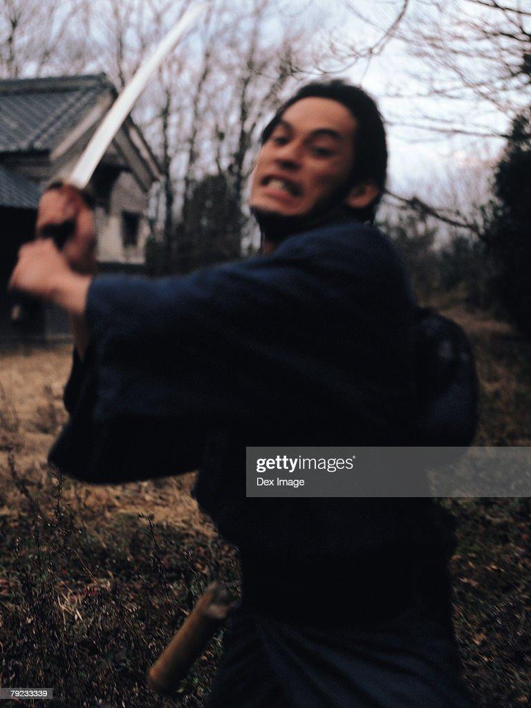 Samurai warrior striking an attack : Stock Photo