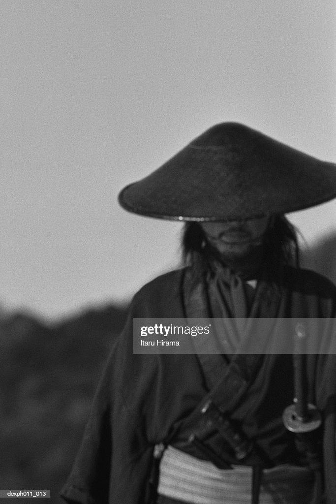 Samurai warrior wearing a conical hat   Stock Photo e6c1241f84c