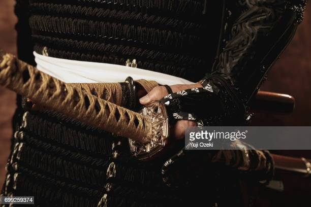 samurai wearing armor holding swords - samurai stock pictures, royalty-free photos & images
