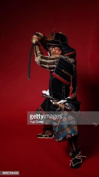 Samurai wearing glasses with armor setting sword