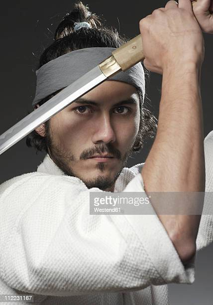 Samurai with sword, portrait