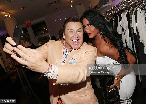Samy and Maripily Rivera take a selfie at Studio LX during the clothing launch of Chiquinquira Delgado in collaboration with David Lerner on May 7...
