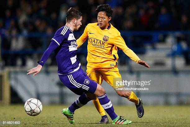 Samy Bourard of Anderlecht battles for the ball with Seungwoo Lee of Barcelona during the UEFA Youth League Quarterfinal match between Anderlecht and...