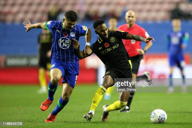 Samy Morsy of Wigan Athletic and Rico Henry of Brentford battle for possession during the Sky Bet Championship match between Wigan Athletic and...