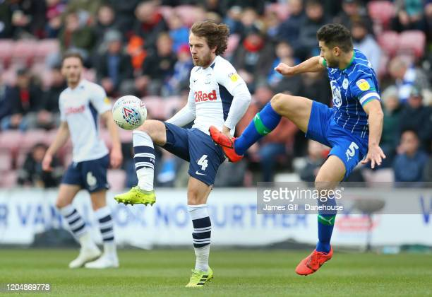 Samy Morsy of Wigan Athletic challenges Ben Pearson of Preston North End during the Sky Bet Championship match between Wigan Athletic and Preston...
