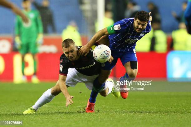 Samy Morsy of Wigan Athletic tackles George Puscas of Reading FC during the Sky Bet Championship match between Wigan Athletic and Reading at DW...
