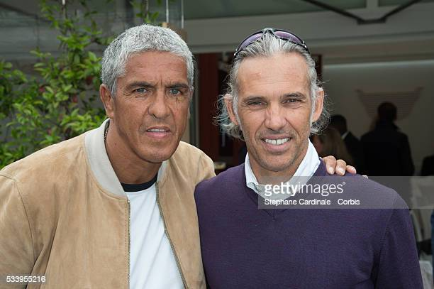 Samy Naceri and Paul Belmondo attend the 2016 French tennis Open day 3 at Roland Garros on May 24 2016 in Paris France