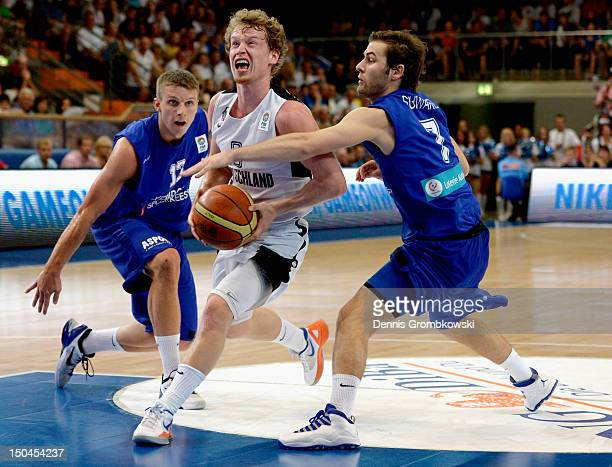 Samy Picard of Luxembourg and teammate Laurent Schwartz challenge Per Guenther of Germany during the EuroBasket 2013 Qualifier match between Germany...