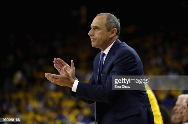 San Antonio assistant coach Ettore Messina claps for his team during Game Five against the Golden State Warriors of Round One of the 2018 NBA...