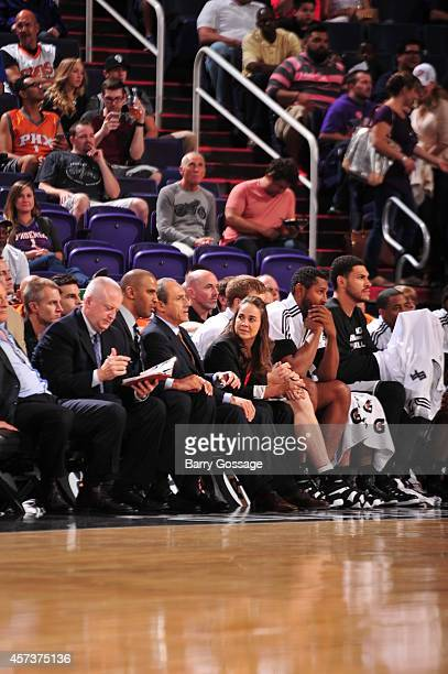 San Antonio coaches Ime Odoka Ettore Messina and Becky Hammon talk during a preseason game against the Phoenix Suns on October 16 2014 at US Airways...