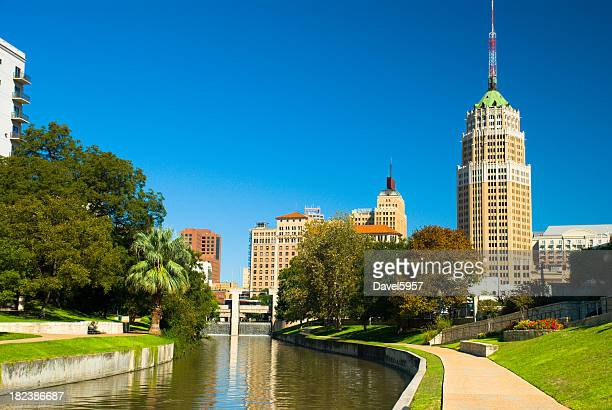 san antonio downtown skyline and riverwalk - san antonio texas stock photos and pictures