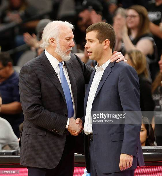 San Antonio head coach Gregg Popovic greets Boston Celtics head coach Brad Stevens at the end of the game at ATT Center on December 14 2016 in San...