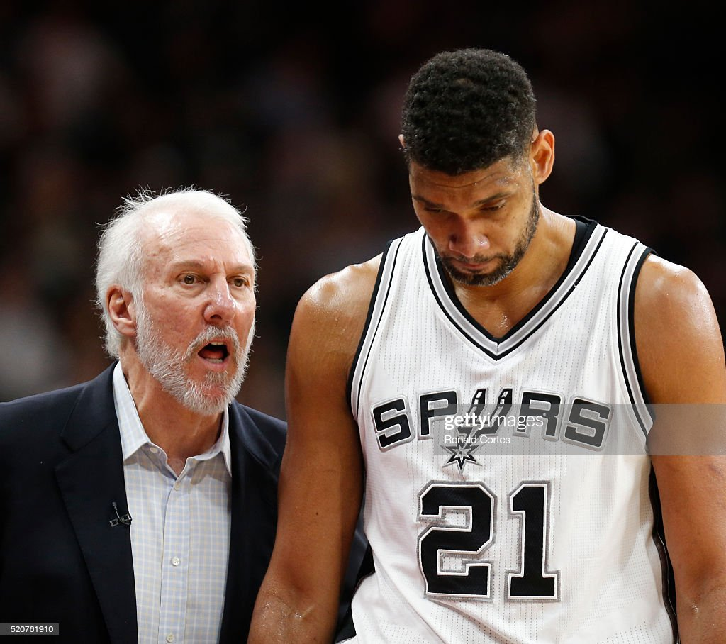 San Antonio head coach Gregg Popovic talks with Tim Duncan #21 of the San Antonio Spurs as he comes out against the Oklahoma City Thunder at AT&T Center on April 12, 2016 in San Antonio, Texas.