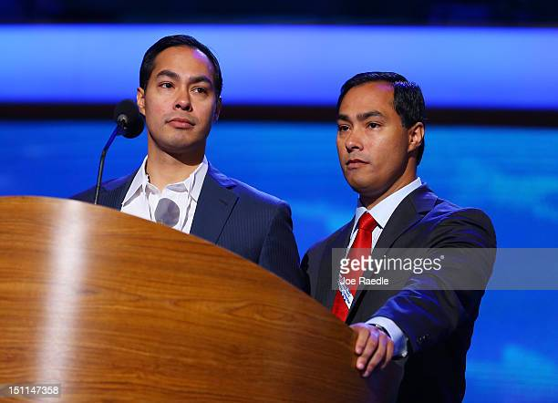 San Antonio Mayor Julian Castro stands on stage at the podium with his brother Joaquin Castro Texas House of Representative Democrat during...