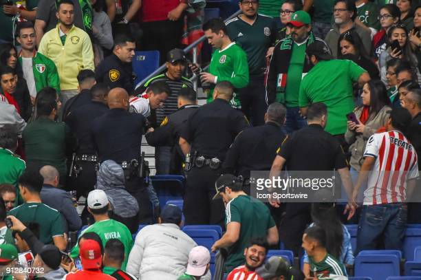 San Antonio police are summoned to the stands in the closing seconds of the soccer match between Mexico and Bosnia Herzegovina on January 31 2018 at...