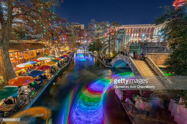 san antonio river walk with christmas lights in texas usa - san antonio texas stock photos and pictures
