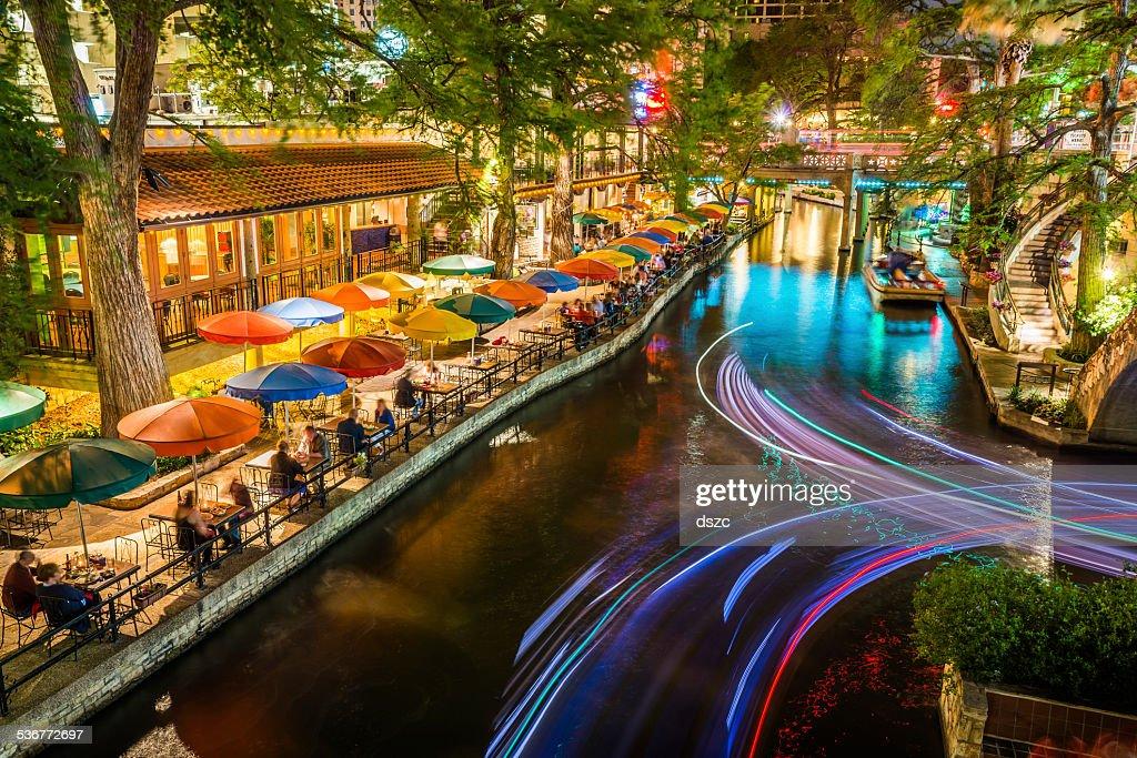 San Antonio Riverwalk, Texas, scenic river canal tourism umbrellas night : Stock Photo