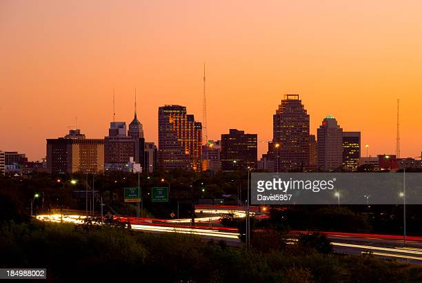 san antonio skyline and highway at dusk - san antonio texas stock photos and pictures
