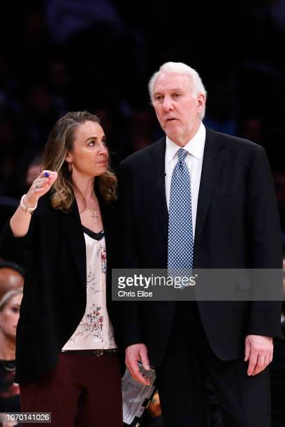 San Antonio Spurs Assistant Coach Becky Hammon talks to Head Coach Gregg Popovich of the San Antonio Spurs during a game on December 05 2018 at the...
