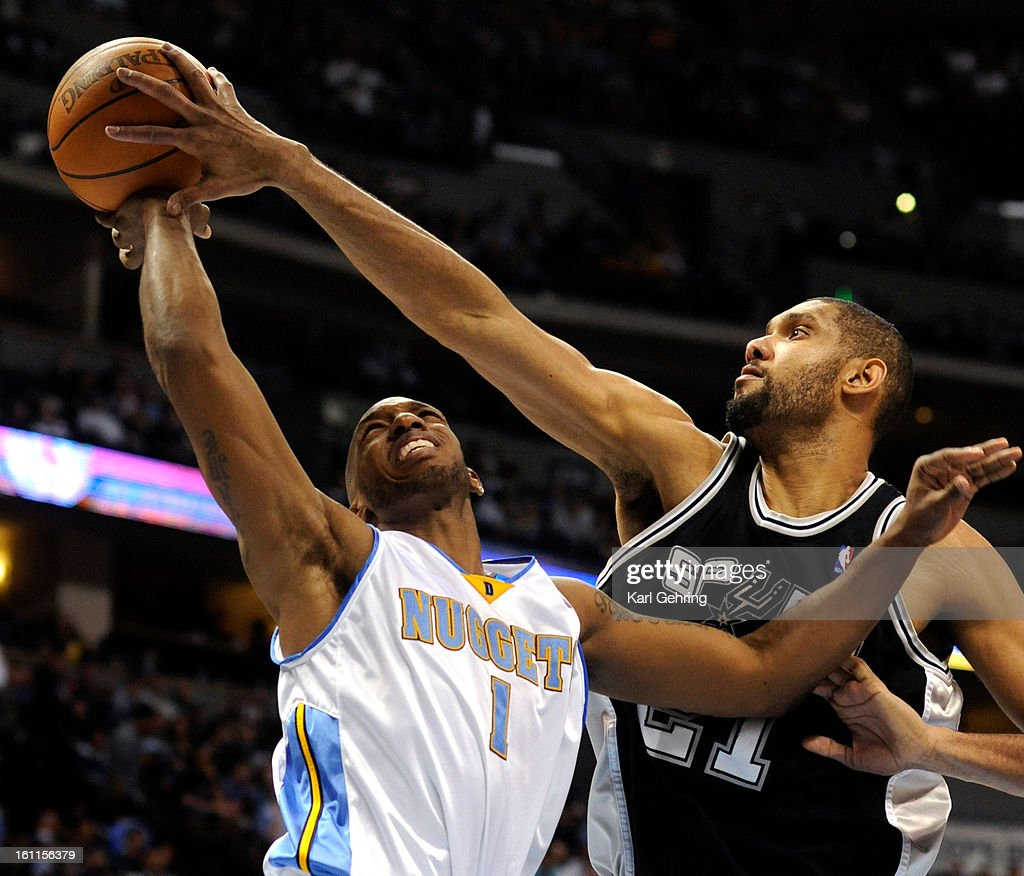 San Antonio Spurs center Tim Duncan (21) went for a block on Denver Nuggets guard Chauncey Billups (1) in the second half. The Denver Nuggets lost to the San Antonio Spurs Thursday night, February 11, 2010 at the Pepsi Center. Karl Gehring, The Denver Pos : News Photo
