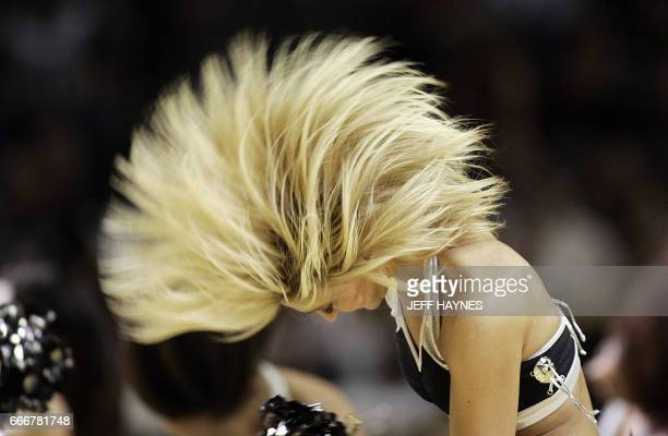 A San Antonio Spurs Dancer performs during Game Two of the NBA Finals at the ATT Center 10 June 2007 in San Antonio Texas The Spurs won game 10392 to...