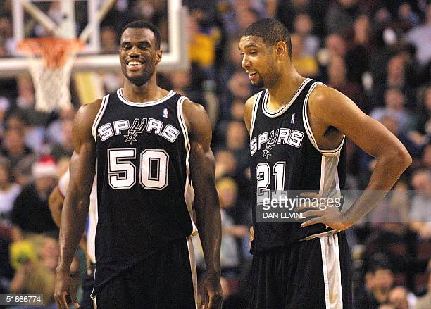 San Antonio Spurs David Robinson and Tim Duncan breath sighs of relief after they completed an AlleyOop basket by Robinson against the Seattle...