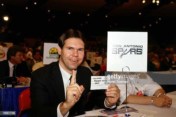 San Antonio Spurs Draft representative holds up a card with name of David Robinson written on it as he is selected in the first round in 1987 in New...