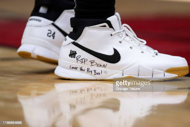 San Antonio Spurs forward DeMar DeRozan wears shoes with the words RIP Bean Love You Big Bro in honor of Kobe Bryant during the first half against...
