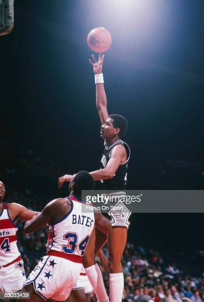 San Antonio Spurs' George Gervin jumps for a layup against the Washington Bullets during a game at Capital Centre circa 1982 in Washington, D.C.....