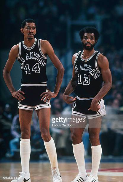 San Antonio Spurs' George Gervin stands next to James Silas on the court during a timeout against the Washington Bullets at Capital Centre circa 1978...