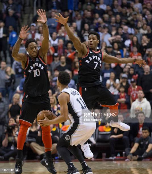 San Antonio Spurs guard Bryn Forbes looks to put up a tying shot as time is about to expire when Toronto Raptors guard DeMar DeRozan and Toronto...