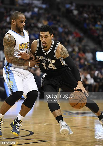 San Antonio Spurs guard Danny Green drives on Denver Nuggets guard Jameer Nelson during the second quarter January 5 2016 at Pepsi Center