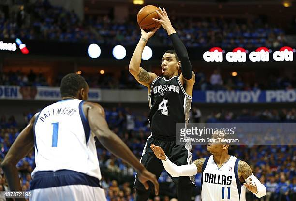 San Antonio Spurs guard Danny Green hits a twopoint shot against the Dallas Mavericks in Game 6 of an NBA Western Conference quarterfinal at the...