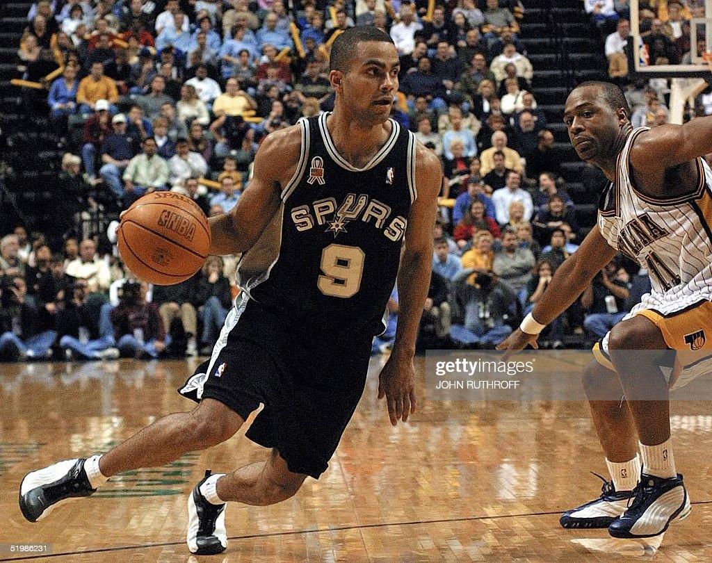 San Antonio Spurs guard Tony Parker (L) works his : News Photo