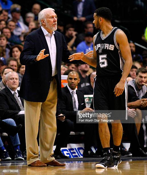 San Antonio Spurs head coach Gregg Popovich talks with guard Cory Joseph during the first half against the Dallas Mavericks at American Airlines...