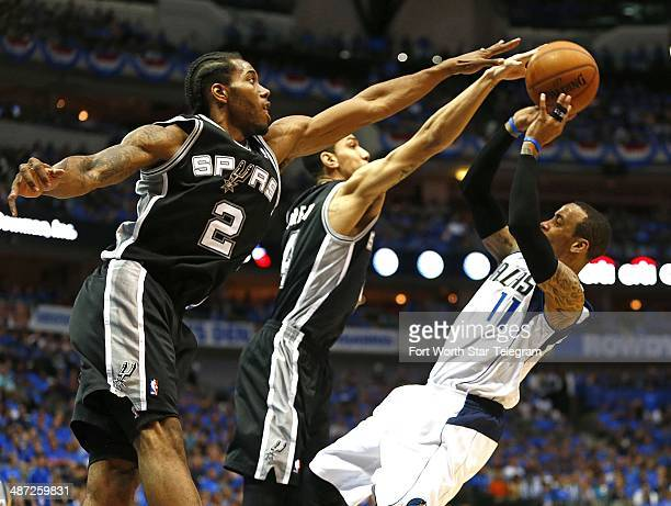 San Antonio Spurs Kawhi Leonard and Danny Green pressure Dallas Mavericks guard Monta Ellis during Game 4 of the NBA Western Conference quarterfinals...