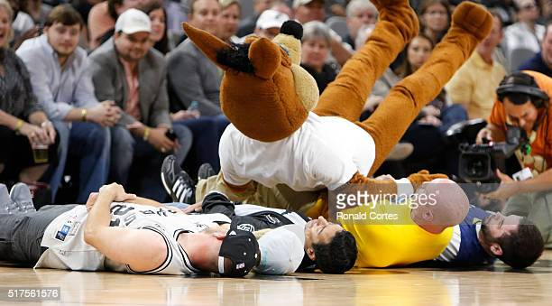San Antonio Spurs mascot Coyote fails in his attempt to leap over four fans during timeout game against the Memphis Grizzlies at ATT Center on March...