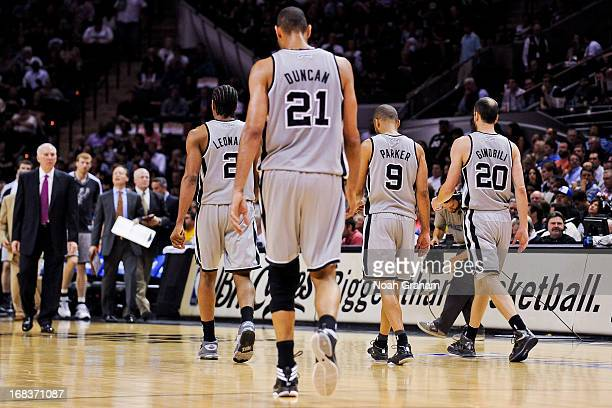 San Antonio Spurs players Kawhi Leonard Tim Duncan Tony Parker and Manu Ginobili walk to the sideline for a timeout while playing the Golden State...