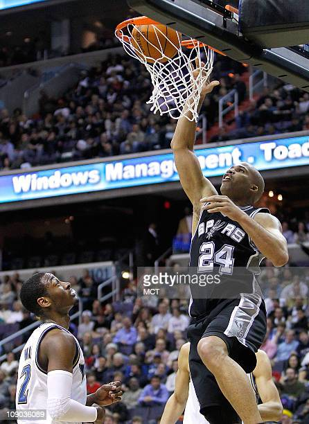 San Antonio Spurs small forward Richard Jefferson scores as Washington Wizards point guard John Wall watches during their game played at the Verizon...