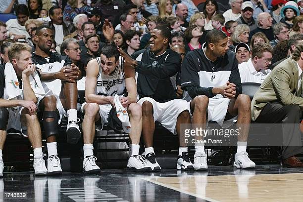 San Antonio Spurs Steve Kerr David Robinson Emanuel Ginobili Stephen Jackson and Tim Duncan share a laugh on the bench during the game against the...