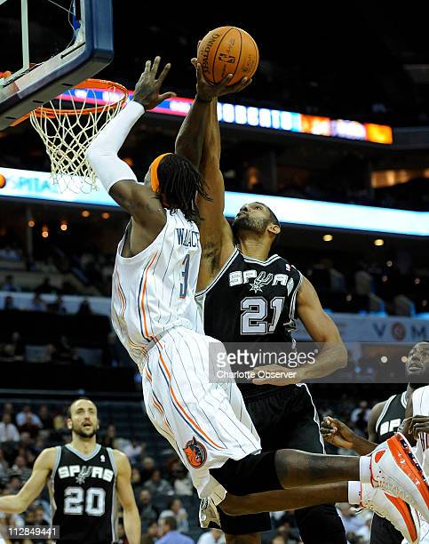 San Antonio Spurs' Tim Duncan blocks the shot of Charlotte Bobcats' Gerald Wallace during the first half at Time Warner Cable Arena in Charlotte...